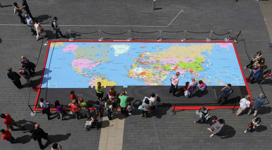 Members of the public help to construct a large map of the world from Lego bricks on August 4, 2012 in London. Photo: Oli Scarff, Getty Images / 2012 Getty Images