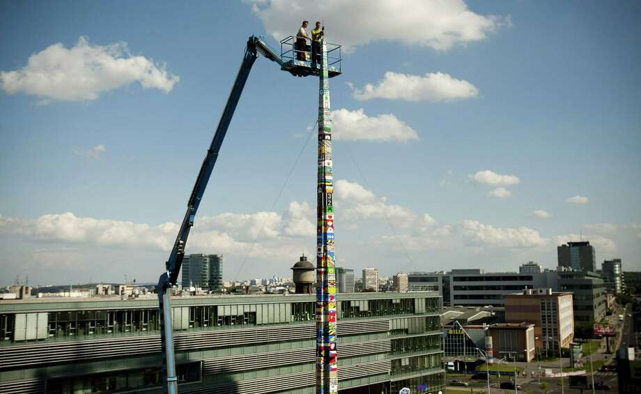 The world's tallest Lego tower is completed on September 9, 2012 in Prague, Czech Republic. It measured 106.6 feet, beating the previous record of 105.5 feet, set in Berlin. Photo: Isifa, Getty Images / 2012 Getty Images