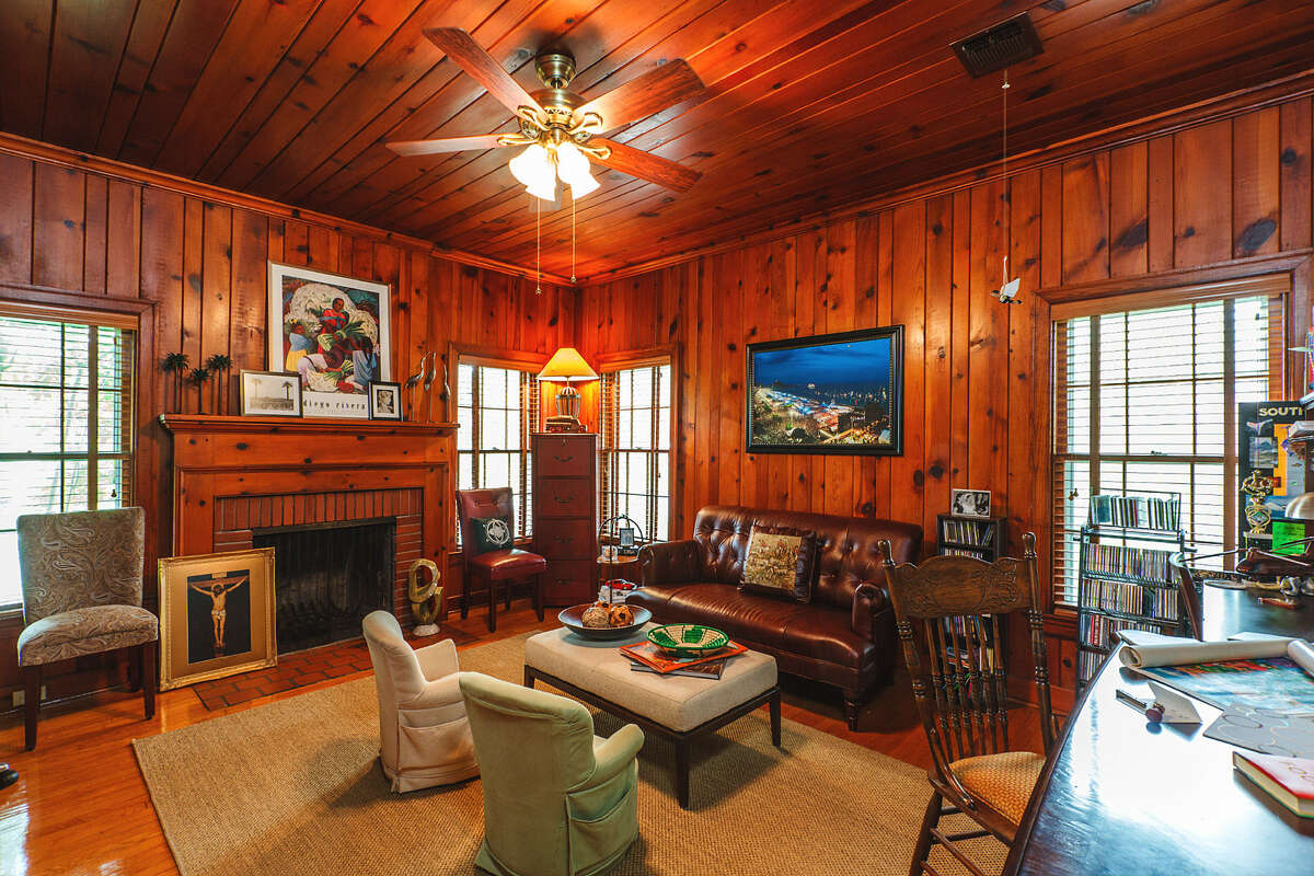 """The """"judge's chamber"""" has warm wood paneling. A previous owner of the home was a judge, who used a separate front door to enter the """"chamber"""" for consultations."""