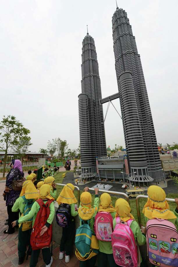 School children check out a Lego model of the Petronas twin towers on September 14, 2012 at Malaysia's Legoland Park in Johor Bahru. Photo: ROSLAN RAHMAN, AFP/Getty Images / 2012 AFP