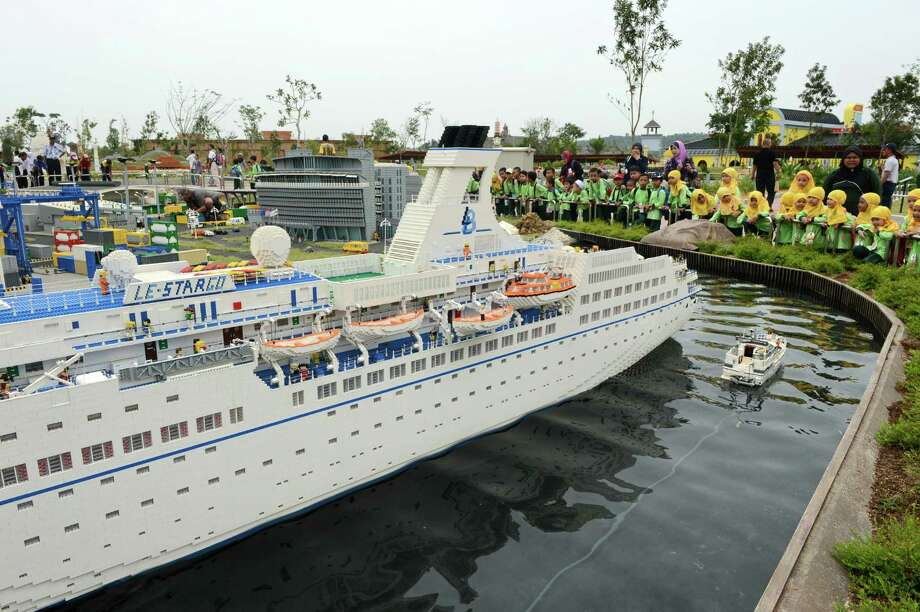 School children look at a Lego cruise ship at Malaysia's Legoland Park in Johor Bahru on September 14, 2012. Photo: ROSLAN RAHMAN, AFP/Getty Images / 2012 AFP