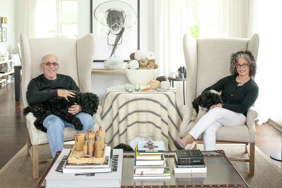 Charles Gold and Peri Wolfman, with their cockapoos Teddy (left) and Tallulah, moved from a 4,500-square-foot home to one less than half that size. Photo: Eric Striffler / New York Times