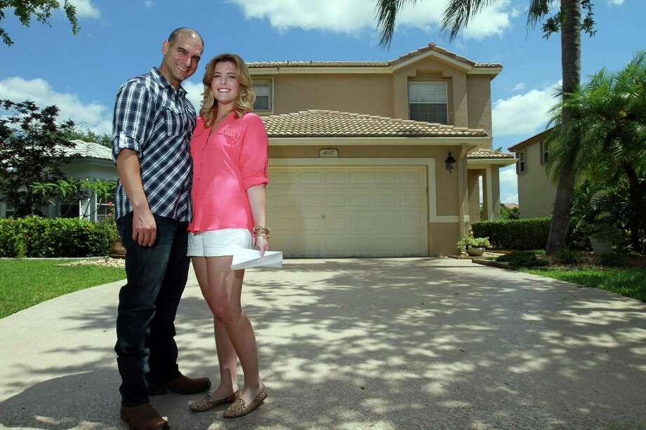 Dave Mollinea, 35, and his fiancee, Heather Cameron, 23, stand in front of the Coconut Creek, Fla., home they are under contract to buy. Photo: Amy Beth Bennett / McClatchy-Tribune News Service