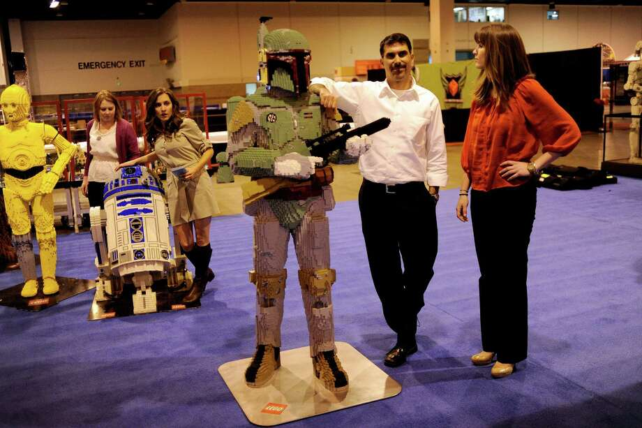 Justin Bresler and Brittany Froelisch of Denver hang out with a Lego Boba Fett during setup for Lego KidsFest at the Colorado Convention Center on Thursday, April 26, 2012. Photo: AARON ONTIVEROZ, DP / (C) 2012 The Denver Post, MediaNews Group
