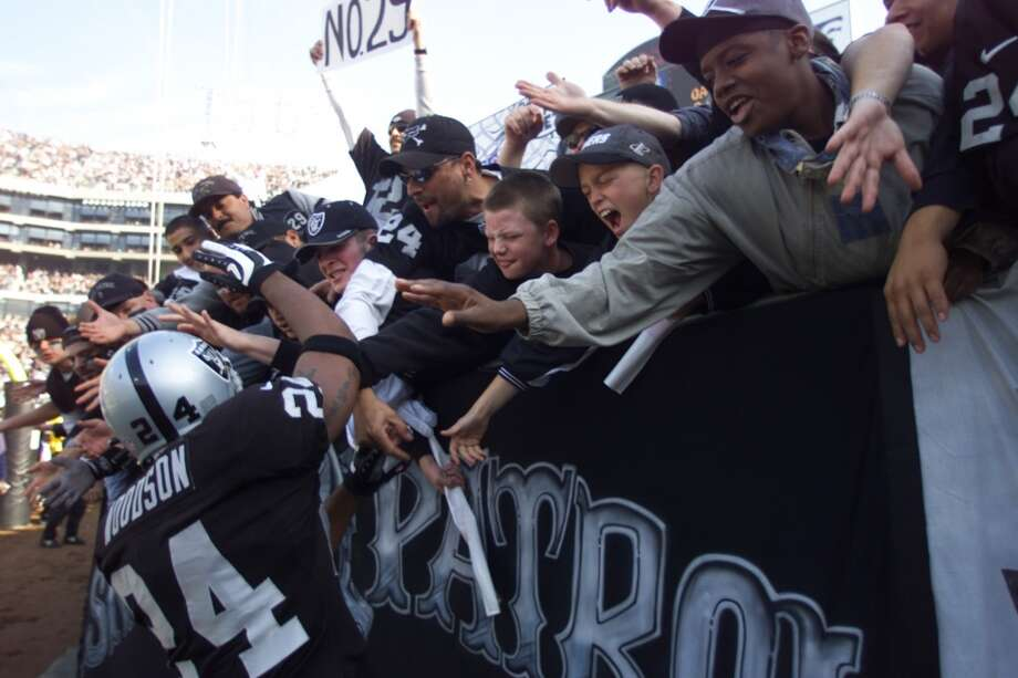 Charles Woodson feels the love from the fans as he takes the field in 2001.
