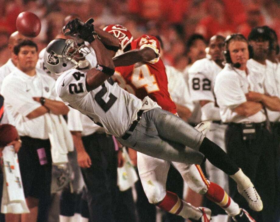 Oakland Raiders cornerback Charles Woodson breaks up a pass intended for Kansas City Chiefs wide receiver Joe Horn (84) in this Sept. 6, 1998 photo in Kansas City, Mo. Woodson was selected as the 1998 NFL Defensive Rookie of the Year on Monday, Jan. 4, 1999, in balloting by The Associated Press.