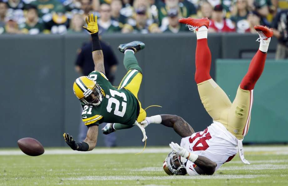 Green Bay Packers' Charles Woodson breaks up a pass intended for San Francisco 49ers' Delanie Walker.