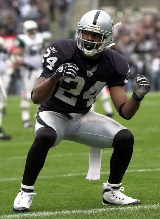 Oakland Raiders cornerback Charles Woodson celebrates after breaking up a pass against the New York Jets during their AFC divisional playoff game Sunday Jan. 12, 2003 in Oakland, Calif.
