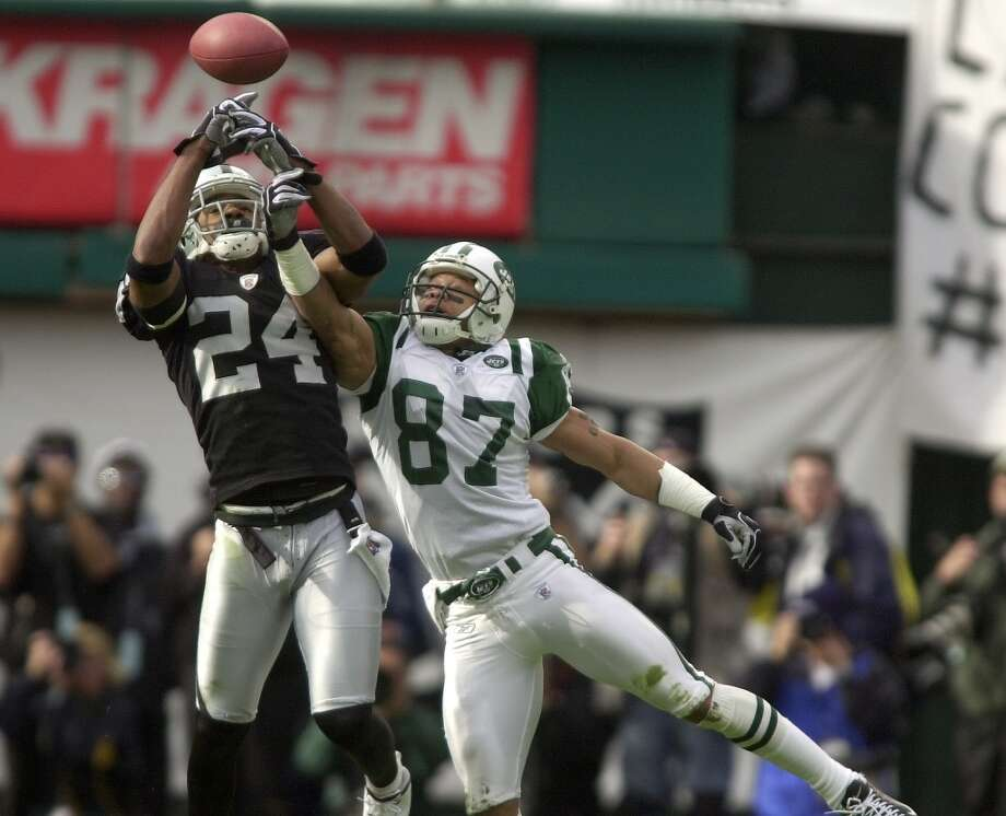 Charles Woodson breaks up a pass intended for Jets #87 James Dearth in first quarter action. The Oakland Raiders played the New York Jets in an AFC playoff game at the Oakland Coliseum January 12, 2003.