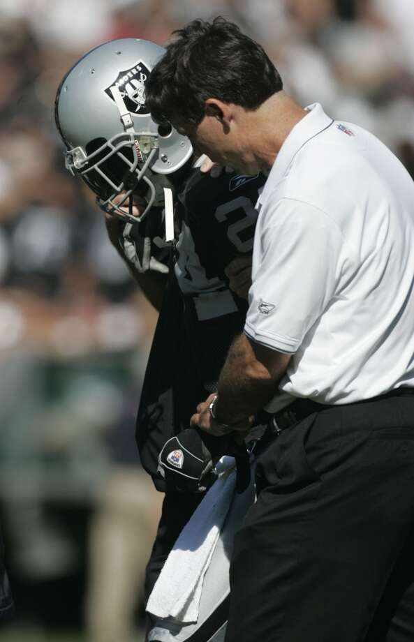 Charles Woodson is helped off the field after being injured in 2005.