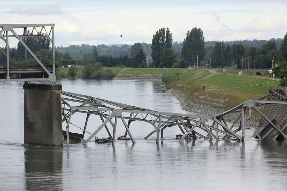 The crumpled I-5 bridge is shown the day after the bridge over the Skagit River between Mount. Vernon and Burlington, Wash., collapsed. Three people were rescued from the water. Two cars and one travel 