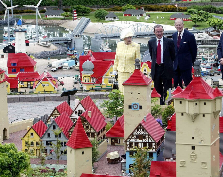Speaking of celebrities, here's Queen Elizabeth II, with Lego President Kjeld Kirk Kristiansen, center, and the Duke of Edinburgh, inspecting miniature models depicting housing in Denmark at Legoland in Windsor on June  10, 2003. Photo: AFP, AFP/Getty Images / 2003 AFP