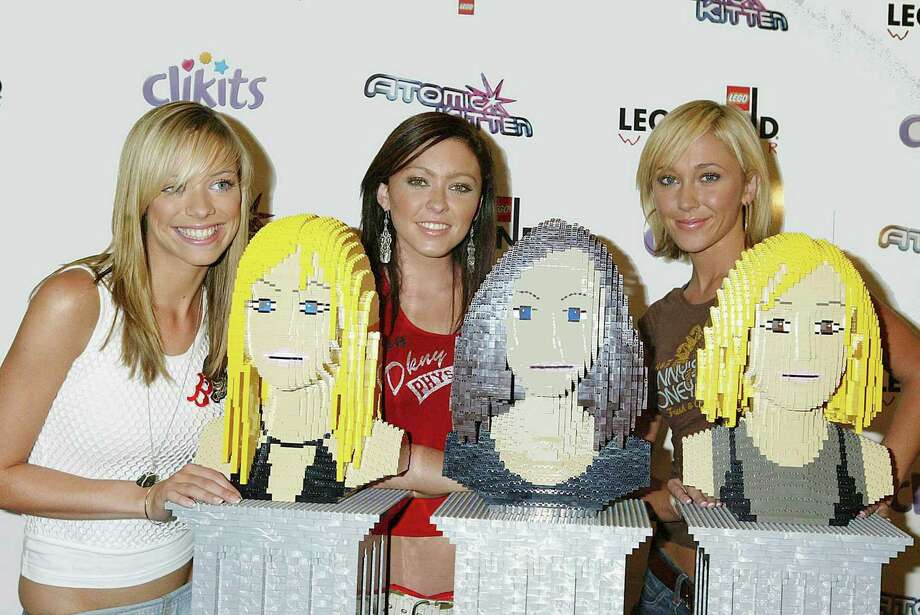 Members of the pop girl group Atomic Kitten pose with their Lego likenesses during their induction into the Legoland Hall of Fame on July 16, 2003 in Windsor, England. Photo: Jo Hale, Getty Images / 2003 Getty Images