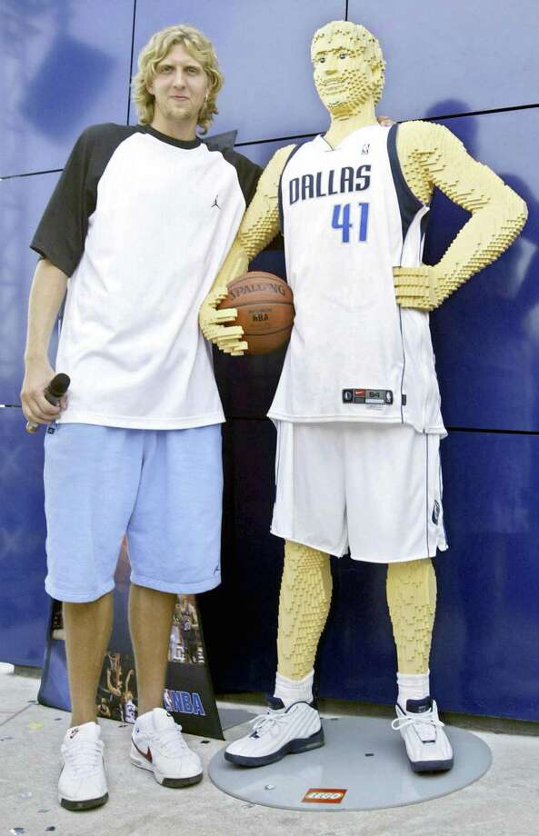 Now that we're in to sports, here's German NBA player Dirk Nowitzki beside his Lego likeness in the Legoland in Guenzburg, Germany, on August 5, 2003. Photo: OLIVER LANG, AFP/Getty Images / 2003 AFP