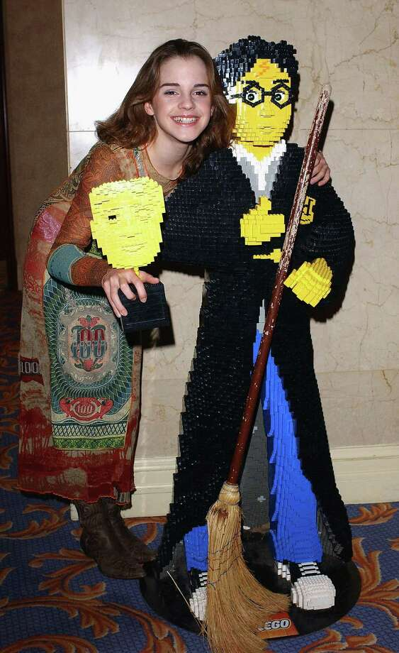 Actress Emma Watson poses with a Lego Harry Potter at the British Academy Children's Film And Television Awards on November 30, 2003 in London. Photo: Steve Finn, Getty Images / 2003 Getty Images
