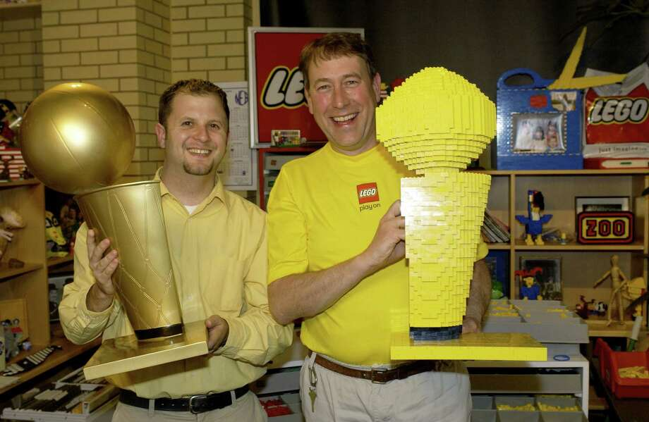Here's a Lego version of the NBA Finals trophy beside a replica of the real trophy on April 27, 2004  in the Lego Systems Facilities in Enfield, Conn. Photo: M. David Leeds, Getty Images / 2004 Getty Images