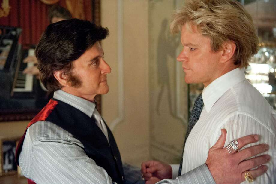"This film image released by HBO shows Michael Douglas, left, as Liberace, and Matt Damon, as Scott Thorson in a scene from ""Behind the Candelabra,"" premiering Sunday at 9 p.m. EDT on HBO. (AP Photo/HBO, Claudette Barius) Photo: Claudette Barius"