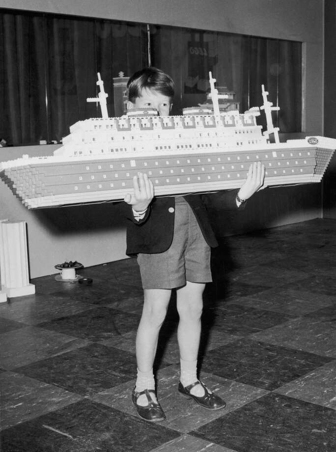 Ships, of course, are an old-school way to travel. Here, Ian Pemberton, 7, carries a Lego ocean liner at a Lego city erected at Selfridges department store in London on August 22, 1962. Photo: Kent Gavin, Getty Images / 2007 Getty Images