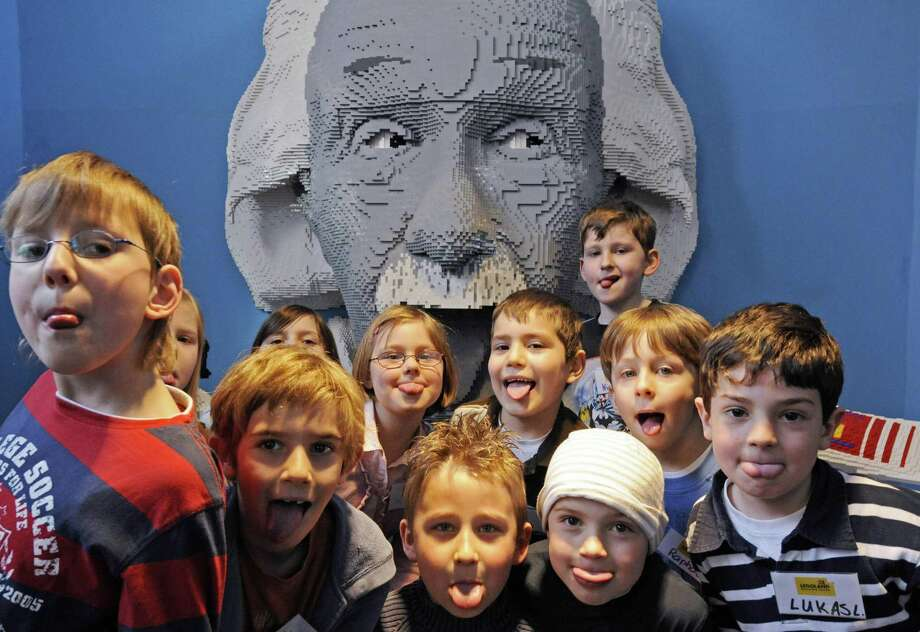 Children pose in front of a Lego Albert Einstein at the Legoland Discovery Center in Duisburg, Germany, on April 17, 2008. Photo: CLEMENS BILAN, AFP/Getty Images / 2008 AFP