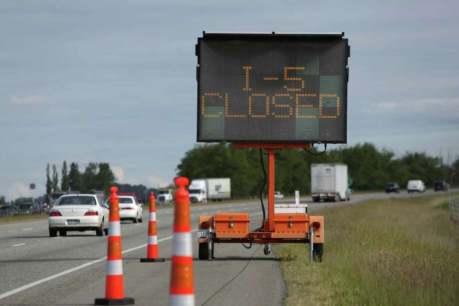A sign warns of the closure of I-5 ahead the day after the Interstate 5 bridge over the Skagit River between Mount Vernon and Burlington, Wash., collapsed. Three people were rescued from the water. Two cars and one travel  trailer plummeted into the water when the section fell.  Photo: JOSHUA TRUJILLO, SEATTLEPI.COM / SEATTLEPI.COM