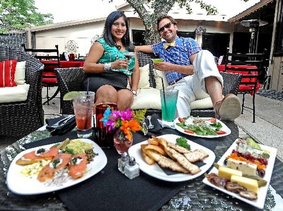 Nathaniel Welch, right, and Meg Baertl, left, sit down over drinks and eats at The Cabana at The Grill. Randy Edwards/cat5, styled by Grace Mathis