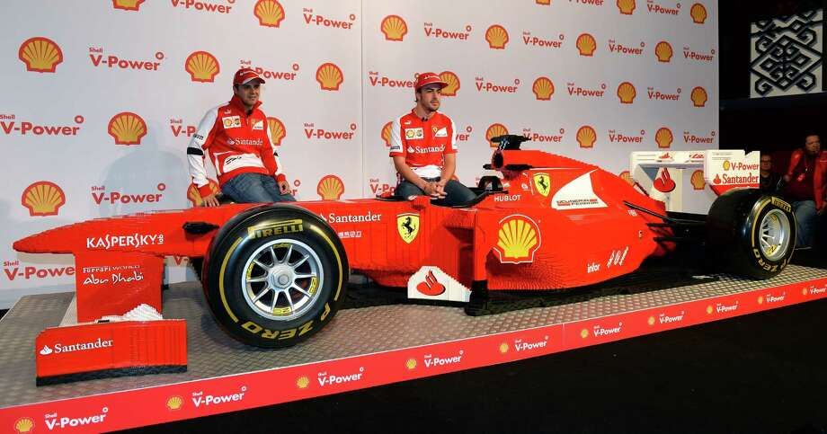 Ferrari drivers Felipe Massa of Brazil (left) and Fernando Alonso of Spain (right) sit on a life-size Ferrari Formula One car built by Lego on Melbourne, Australia, on March 14, before the Formula One Australian Grand Prix. Photo: WILLIAM WEST, AFP/Getty Images / AFP
