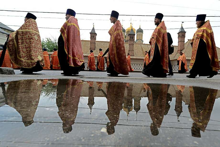Alphabetical order: Russian Orthodox priests line up for a religious procession marking Saints Cyrilius and Methodius' Day in Moscow. The holiday, usually celebrated in countries that observe Eastern Orthodox tradition in May, commemorates brothers Cyrilius and Methodius, the creators of Cyrilic alphabet and symbols of the Slav culture. Photo: Kirill Kudryavtsev, AFP/Getty Images