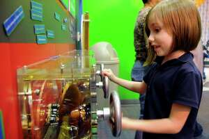 Hazel Britton Dansby enjoys playing at the Children's Museum.