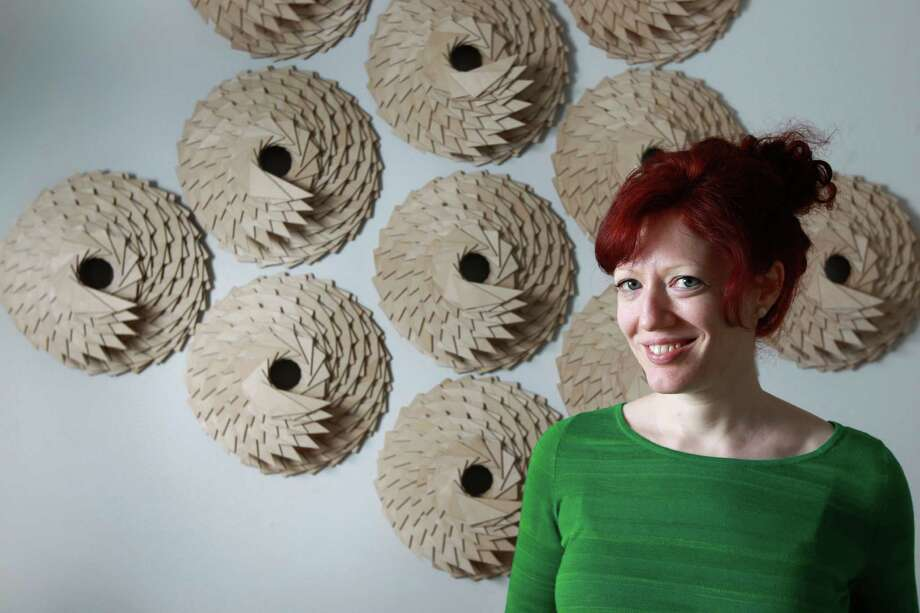 Susannah Mira posses for a portrait with her plywood sculpture that is currently untiled at the Houston Center for Contemporary Craft on Friday, May 3, 2013, in Houston. ( J. Patric Schneider / For the Chronicle ) Photo: J. Patric Schneider, Freelance / © 2013 Houston Chronicle