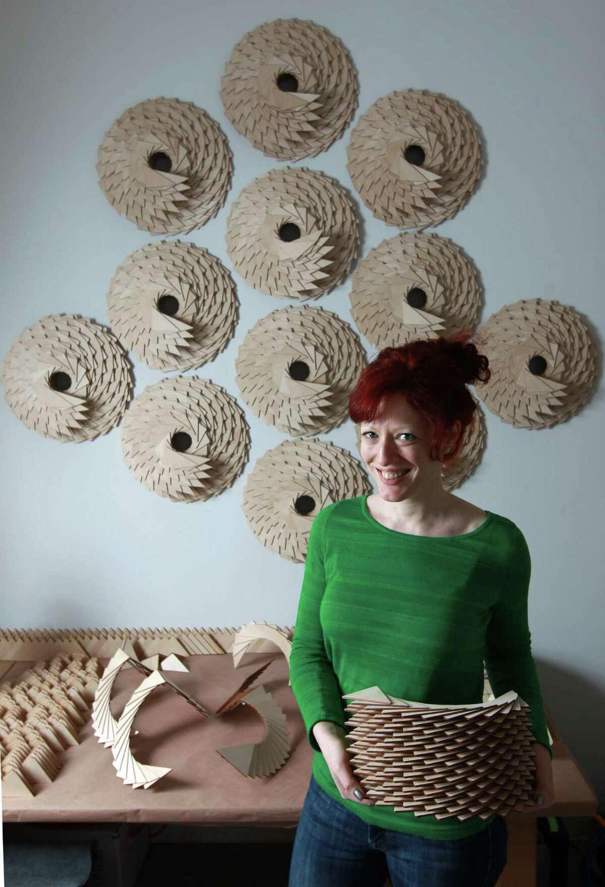 Susannah Mira posses for a portrait with her plywood sculpture that is currently untiled at the Houston Center for Contemporary Craft on Friday, May 3, 2013, in Houston. ( J. Patric Schneider / For the Chronicle )