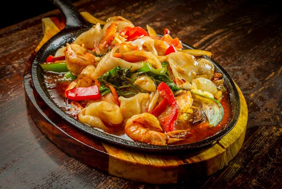 The Seafood Basil Special ($12.95): Large shrimp, mussels, calamari, chunks of fish and vegetables in a spicy, slightly sweet garlicky sauce punctuated with Thai basil.
