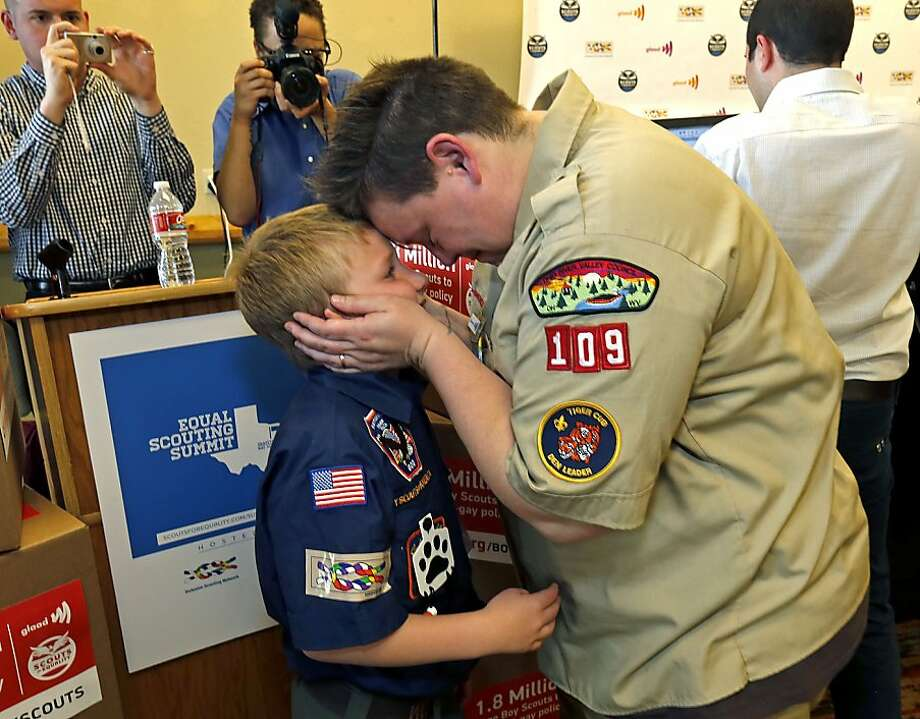 Still barred from Scouting: Jennifer Tyrrell, a Cub Scout den leader who was kicked out of Scouting in 2012 for being openly gay, embraces her son, Cruz, at the Great Wolf Lodge in Grapevine, Texas. The Boy Scouts of America voted Thursday to allow gay boys, but left intact its ban on gay adults and leaders. Photo: Stewart House, Getty Images