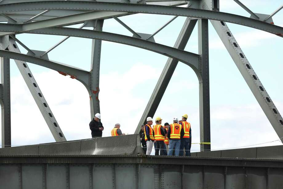 Damage is shown on still-standing sections as crews inspect the scene the day after the Interstate 5 bridge over the Skagit River between Mt. Vernon and Burlington collapsed into the river. Three people were rescued after two cars and a travel trailer fell into the cold water. Photo: JOSHUA TRUJILLO, SEATTLEPI.COM / SEATTLEPI.COM