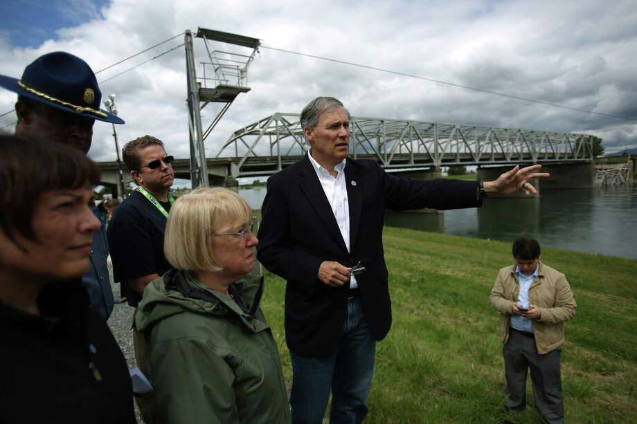 Governor Jay Inslee, center, along with Suzan DelBene, left, Washington State Patrol Chief John Batiste and U.S. Senator Patty Murray look over the scene the day after the Interstate 5 bridge over the Skagit River between Mt. Vernon and Burlington collapsed into the river. Three people were rescued after two cars and a travel trailer fell into the cold water. Photo: JOSHUA TRUJILLO, SEATTLEPI.COM / SEATTLEPI.COM