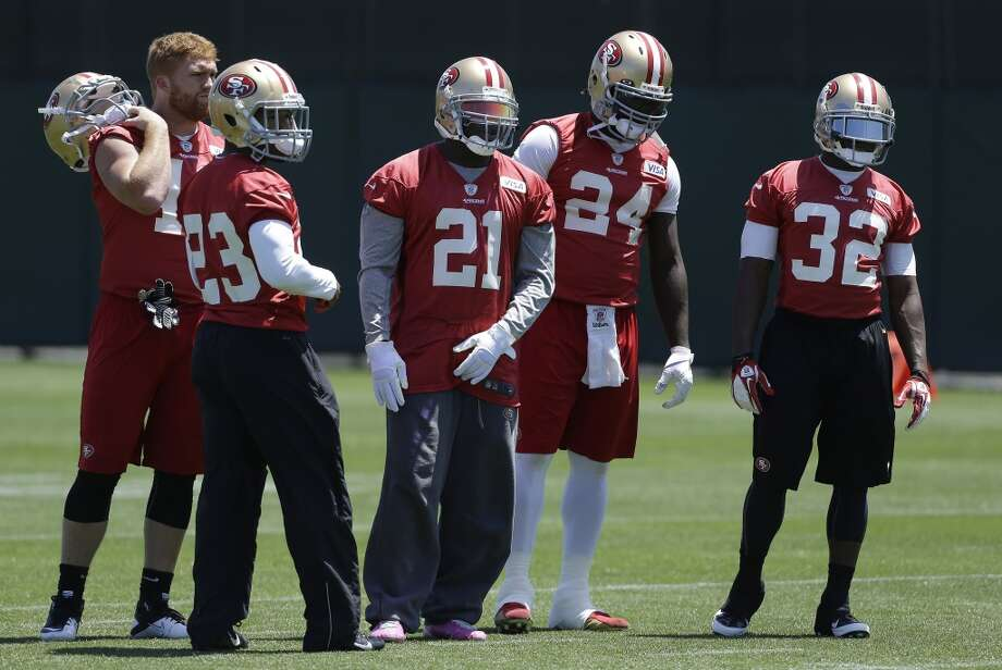 San Francisco 49ers running backs fullback Bruce Miller, left, running back LaMichael James (23), running back Frank Gore (21), running back Anthony Dixon (24) and running back Kendall Hunter (32) practice at an NFL football training camp in Santa Clara, Calif., Wednesday, May 22, 2013. (AP Photo/Jeff Chiu)