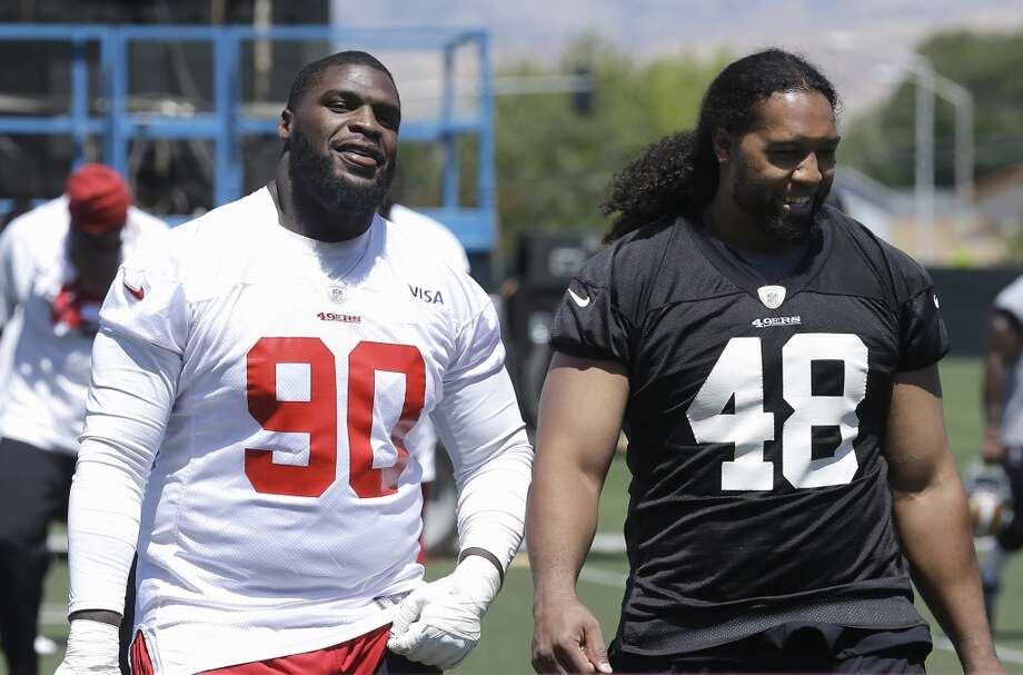 San Francisco 49ers defensive linemen Glenn Dorsey (90) and Will Tukuafu walk off the practice field at an NFL football training camp in Santa Clara, Calif., Wednesday, May 22, 2013. (AP Photo/Jeff Chiu)