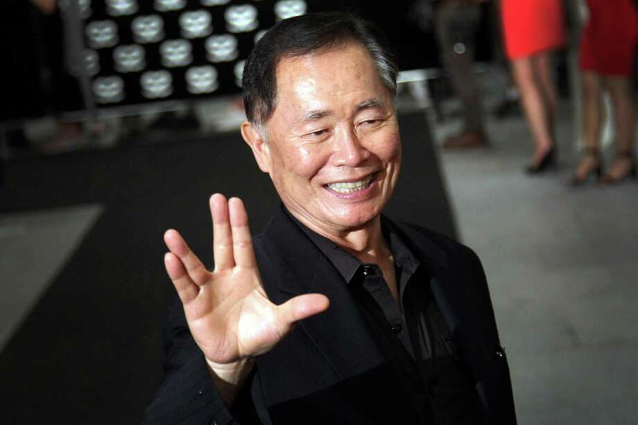 American actor George Takei gestures with a hand greeting made popular by the Television series Star Trek arrives at the Marina Bay Sands hotel on Thursday, May 23, 2013 in Singapore for the inaugural Social Star Awards.(AP Photo/Wong Maye-E) Photo: Wong Maye-E