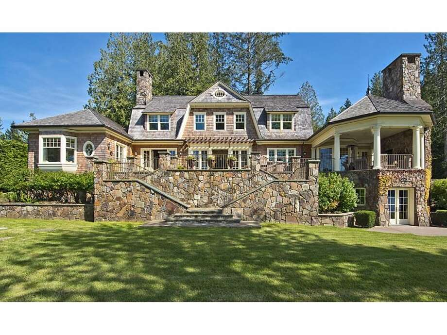 """Having never been to Southampton, it's hard to vouch for this home's claim to be """"Southampton on the Sound."""" Still, the estate, 4225 Boston Harbor Road N.E., in Olympia, intrigued us. The 8,300-square-foot mansion, built in 2004, has four bedrooms, four bathrooms, beamed ceilings, wood walls, an entertainment center, a workout studio, a sauna, a wine cellar, a covered deck with a grill and a workshop on 2.29 acres with 165 feet of waterfront. It's listed for $5.2 million. Photo: Courtesy Chris Doucet,  Realogics Sotheby's International Realty"""