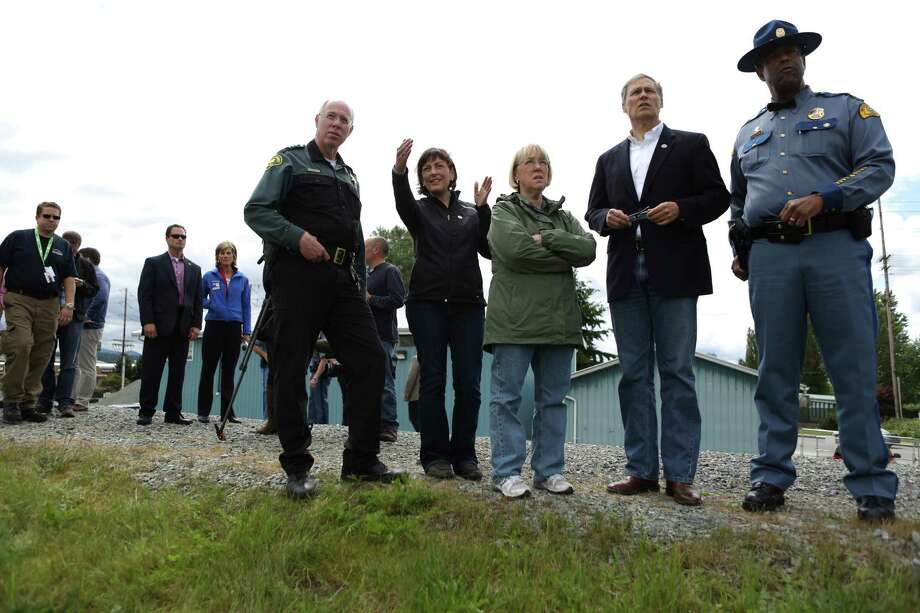 From left, Skagit County Sheriff Will Reichardt, congresswoman Suzan DelBene, Senator Patty Murray, Governor Jay Inslee and State Patrol Chief John Batiste look over the scene the day after the Interstate 5 bridge over the Skagit River between Mt. Vernon and Burlington collapsed into the river. Three people were rescued after two cars and a travel trailer fell into the cold water. Photo: JOSHUA TRUJILLO, SEATTLEPI.COM / SEATTLEPI.COM