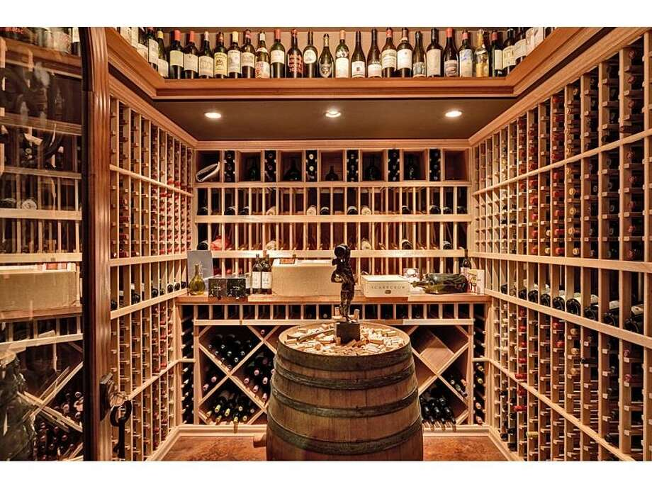 Wine cellar of 4225 Boston Harbor Road N.E., in Olympia, intrigued us. The 8,300-square-foot mansion, built in 2004, has four bedrooms, four bathrooms, beamed ceilings, wood walls, an entertainment center, a workout studio, a sauna, a covered deck with a grill and a workshop on 2.29 acres with 165 feet of waterfront. It's listed for $5.2 million. Photo: Courtesy Chris Doucet, Realogics Sotheby's International Realty