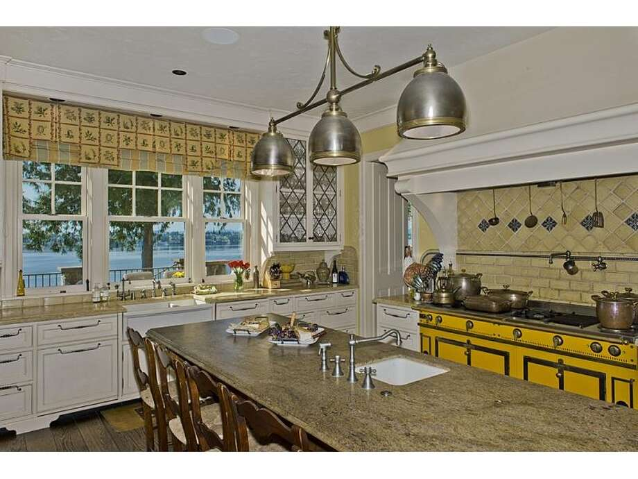 Kitchen of 4225 Boston Harbor Road N.E., in Olympia, intrigued us. The 8,300-square-foot mansion, built in 2004, has four bedrooms, four bathrooms, beamed ceilings, wood walls, an entertainment center, a workout studio, a sauna, a wine cellar, a covered deck with a grill and a workshop on 2.29 acres with 165 feet of waterfront. It's listed for $5.2 million. Photo: Courtesy Chris Doucet, Realogics Sotheby's International Realty