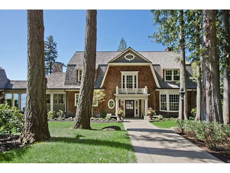 Front of 4225 Boston Harbor Road N.E., in Olympia, intrigued us. The 8,300-square-foot mansion, built in 2004, has four bedrooms, four bathrooms, beamed ceilings, wood walls, an entertainment center, a workout studio, a sauna, a wine cellar, a covered deck with a grill and a workshop on 2.29 acres with 165 feet of waterfront. It's listed for $5.2 million. Photo: Courtesy Chris Doucet, Realogics Sotheby's International Realty