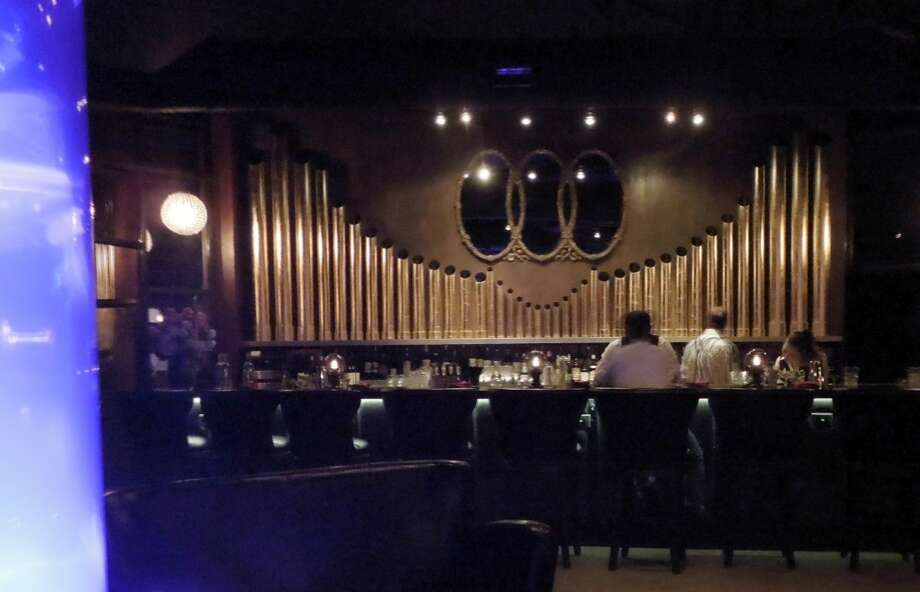 The bar is backed by antique organ pipes. That glow on the left is the jellyfish tank.