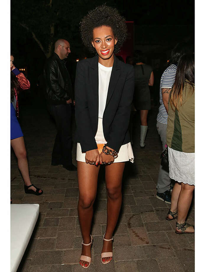 At an event, 2013.Solange proves that you can wear shorts and still look polished — just add a silky tank and classic blazer. Photo: Chelsea Lauren, Getty / 2013 Getty Images
