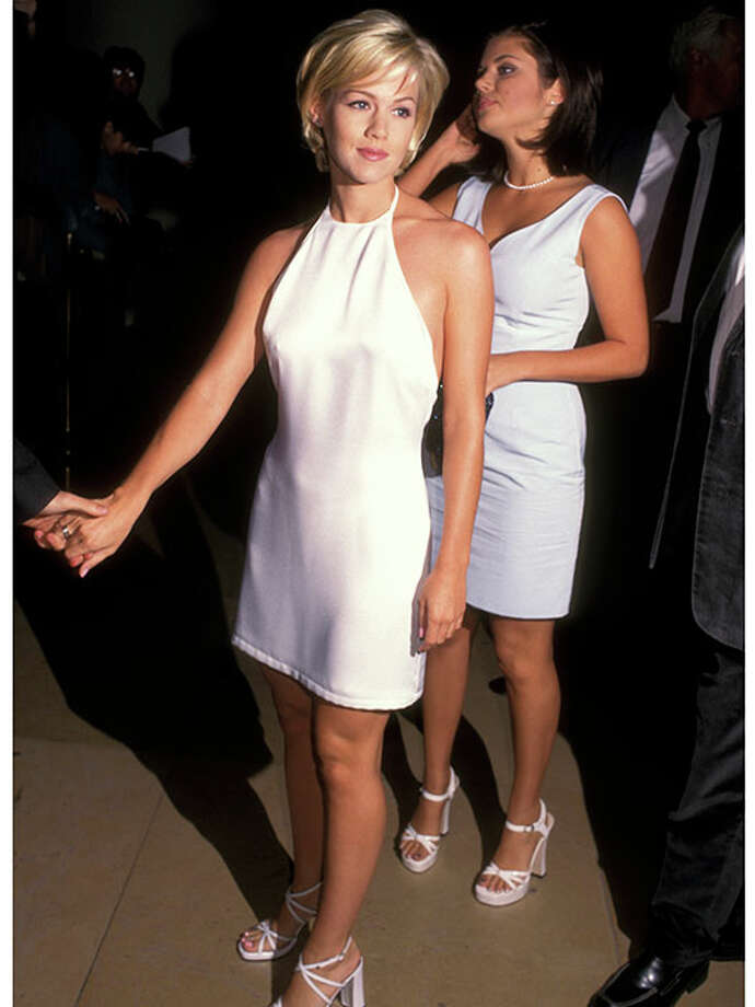 At an event, 1996.You can't go wrong in an LWD — just ask Jennie Garth. Pair it with a pretty metallic sandal and you're occasion-ready. Photo: Ron Galella, Getty