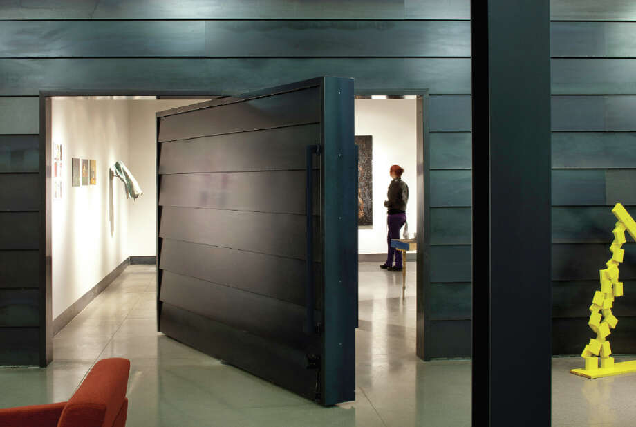 The student gallery is accessed through a rotating door with hot-rolled steel siding. Photo: Integrus Architecture