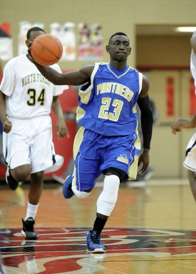Ozen player Jordan Hunter, #23, charges down the court during the Ozen High School Panthers basketball game against the North Forrest  High School Bulldogs on Thursday, December 27, 2012, at the James Gamble Boys Basketball Tournament held at Port Arthur Memorial High School. Ozen won over North Forrest 69 - 42. Photo taken: Randy Edwards/The Enterprise