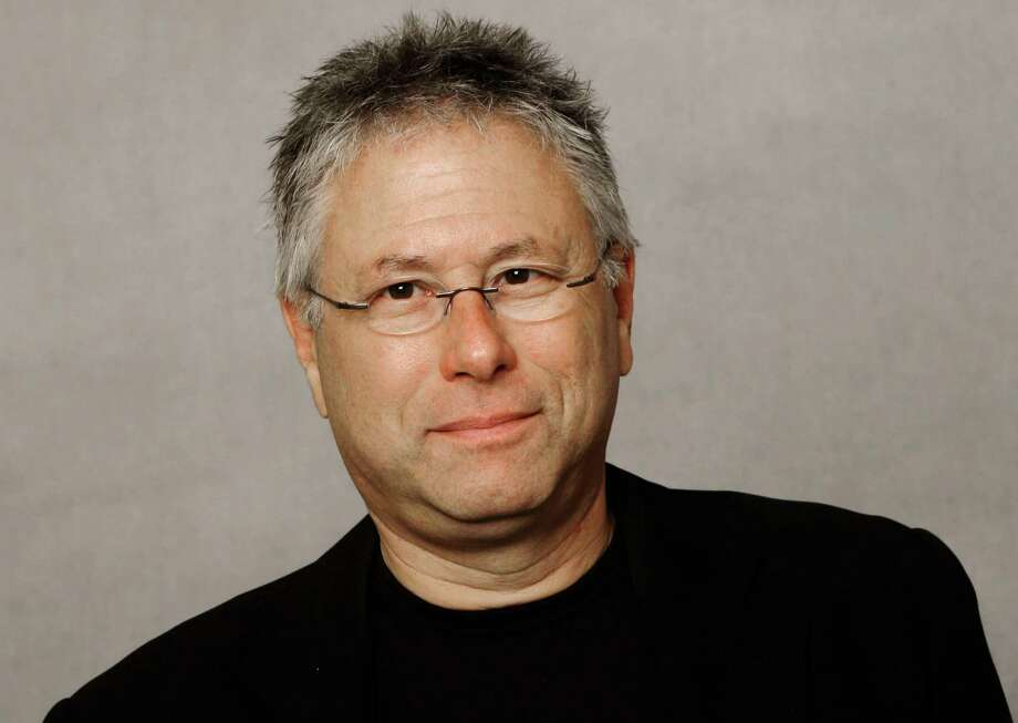 "** CORRECTS MONTH TO FEBRUARY ** Composer Alan Menken poses for a photograph in Beverly Hills Calif., Monday, Feb. 4, 2008. Menken, along with Stephen Schwartz, received three Oscar nominations for the best Original Song category for three different songs from the film ""Enchanted."" (AP Photo/Kevork Djansezian) Photo: Kevork Djansezian, STF / AP"