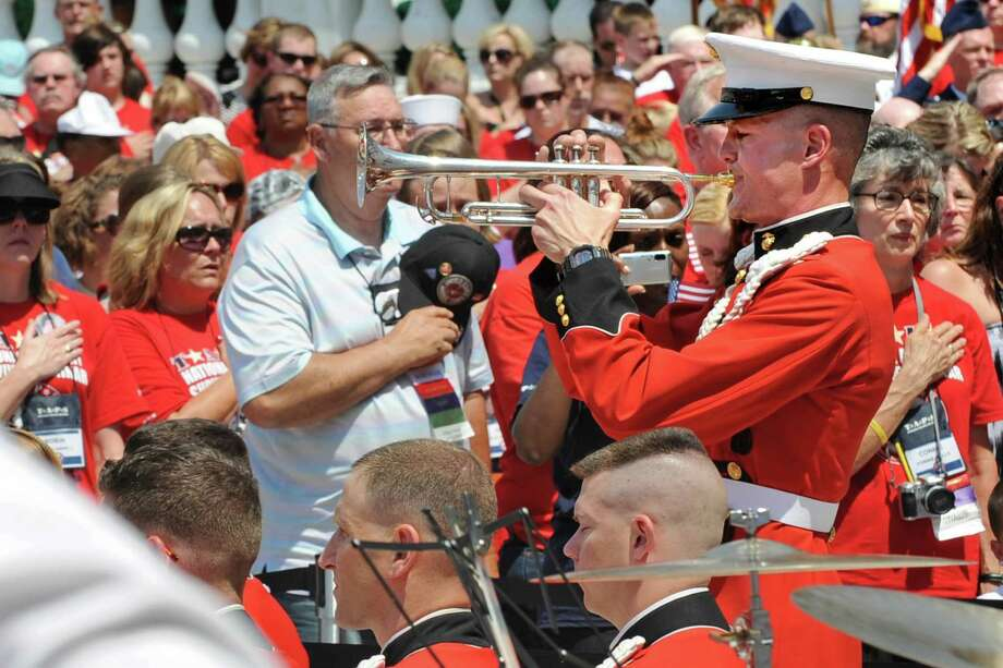 """Marine Band trumpeter Gunnery Sgt. Scott Gearhart plays """"Taps"""" at the close of the Memorial Day commemoration ceremony at the Memorial Ampitheater at Arlington National Cemetery, Arlington, Va., May 30, 2011. Photo: DoD Photo By R.D. Ward/Released, OSD / Digital"""