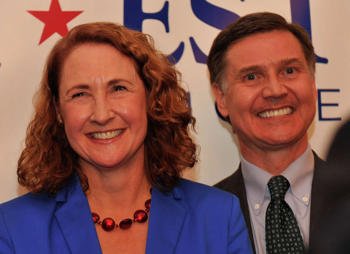 Elizabeth Esty and her husband, Daniel, stand behind Gov. Dannel P. Malloy before Elizabeth gives her acceptance speech after defeating state Sen. Andrew Roraback for the 5th Congressional District at at the CoCo Key Water Resort Convention Center in Waterbury on Tuesday, Nov. 6, 2012. To the right of Elizabeth is her husband, Daniel.